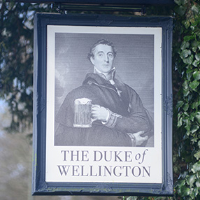 duke-hanging-sign